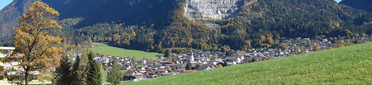 Panoramafoto Bad Häring mit Pölven im Hintergrund